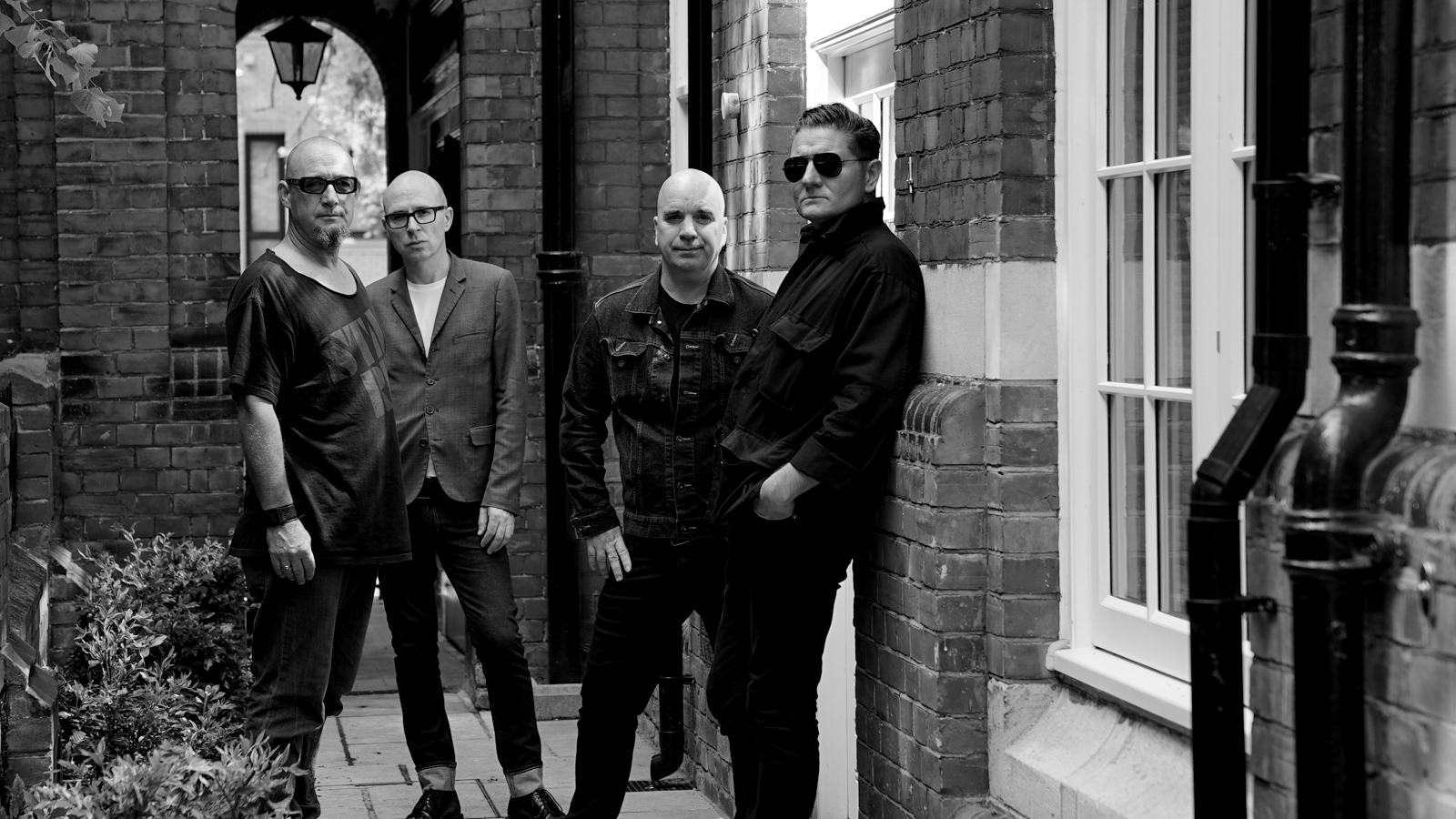Nitzer Ebb Pared Down to Bon Harris and Douglas McCarthy for First North American Shows Due to Visa Delays